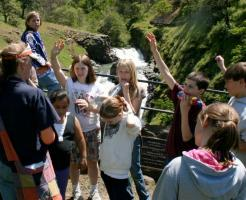 Science Teacher Kim Leslie talks about Jonah Mosier's lumber mill at the Mosier Creek Falls.